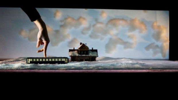 Intricate hand movements are projected on a big screen in Jaco van Dormael's Kiss & Cry.