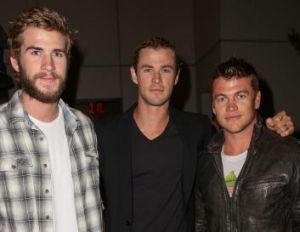 Brotherly love: Chris Hemsworth, centre, has a tight relationship with siblings Liam, left, and Luke - the older pair ...