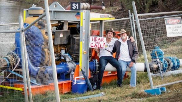 Luke O'Shea and his father Rick protest the Maules Creek mine near Narrabri.