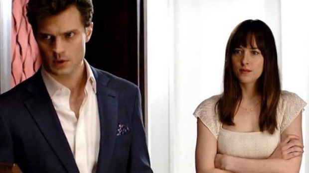 Dakota Johnson and Jamie Dornan in the movie adaptation of <i>Fifty Shades of Grey</i>.