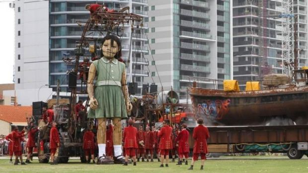 The Little Girl Giant relied on her Lilliputian helpers to help her get dressed.
