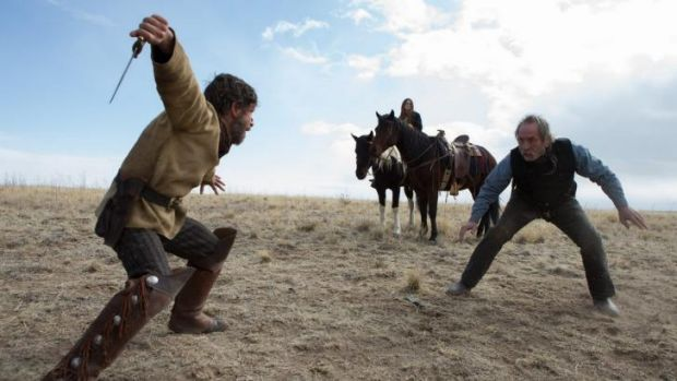 Tommy Lee Jones, right, does battle in <i>The Homesman</i>.