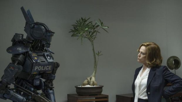 Sigourney Weaver as the chief executive of  a military weapons company with one of the robot cops her company is promoting.
