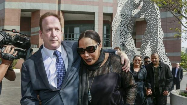 Attorney Richard Busch, left, and Nona Gaye, daughter of the late Marvin Gaye, after a jury awarded the singer's ...