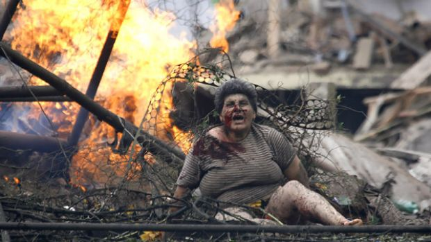 An injured Georgian woman calls for help in the town of Gori, 80 kilometres west of  Tbilisi, after a Russian warplane ...