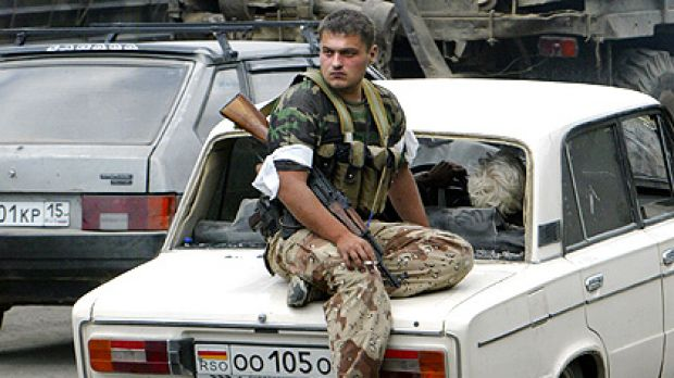 A South Ossetian separatist fighter sits on a car near the town of Dzhava, South Ossetia.