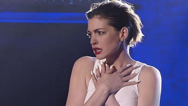 Anne Hathaway impersonating Miley Cyrus on <i>Lip Sync Battle</i>.