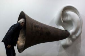 A visitor peers into US artist John Baldessari's <i>Beethoven's Trumpet (With Ear) Opus # 133</i> at this year's Art ...