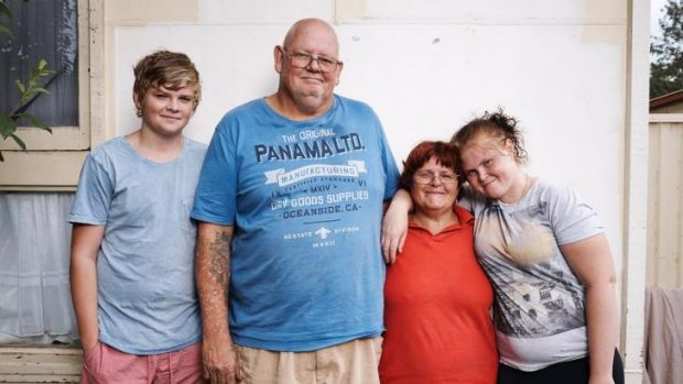 <i>Struggle Street</i> participants: Ashley (second left) and Peta (third left) Kennedy and their family.