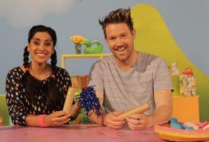 Leah Vandenberg and Eddie Perfect on the <I>Play School</I> set.
