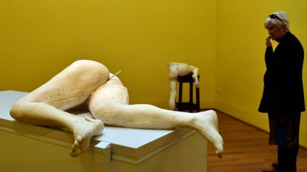 A visitor looks at a creation by British artist Sarah Lucas in the Great Britain pavilion.