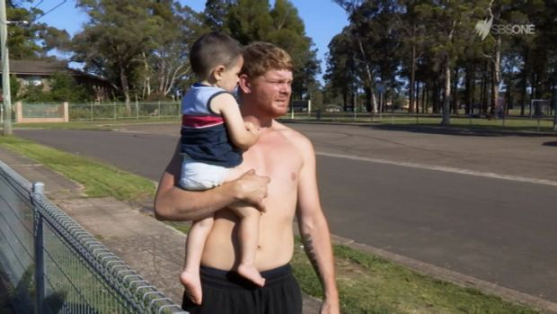 Ice addict Corey holds his son Liam in the final episode of <em>Struggle Street</em>.