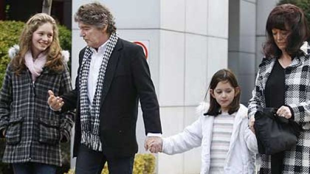 Jim Keays and wife Karin outside of Coroners Court, with daughters Holly, 12  and Bonnie, 6 after the finding on their ...