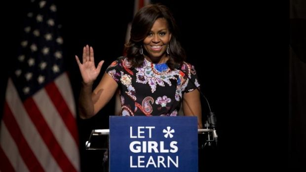 US first lady Michelle Obama waves as she receives a rock star reception by school girls at Mulberry School for Girls ...