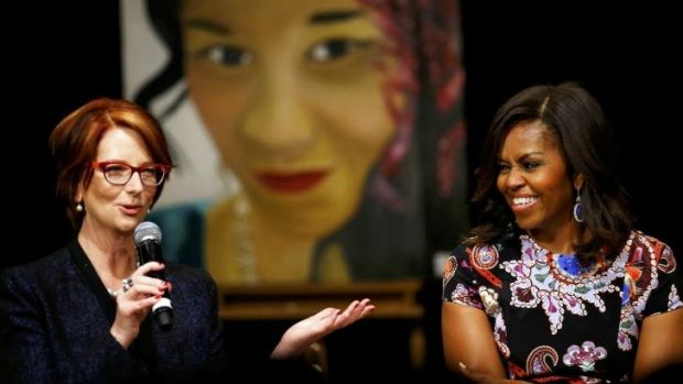 Seize your dreams ... Julia Gilllard (left) joins US First Lady Michelle Obama to speak to pupils during a visit to ...