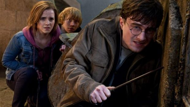 Danielle Radcliffe (right) as the boy wizard, with Emma Watson and Rupert Grint, in <i>Harry Potter and the Deathly ...