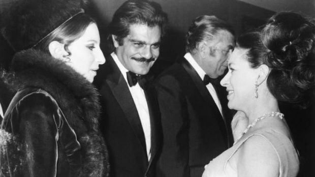 Britain's Princess Margaret, right, talks with Barbra Streisand and Omar Sharif in 1969.