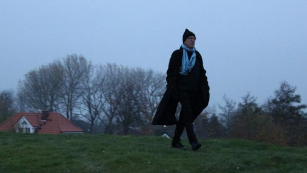 Geoffrey Rush walks through the grounds of St Nikolaus Church in Brokdorf, Germany, in <i>Who Do You Think You Are</i>.