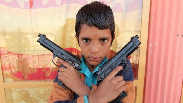 Steel, the young (perhaps 10-year-old) leader of a street gang in Jalalabad, Afghanistan, in George Gittoes' documentary ...