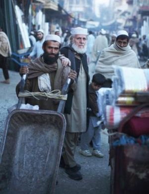 George Gittoes, centre, on the streets of Jalalabad.