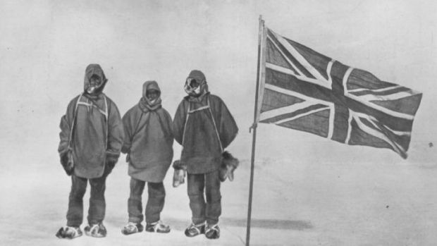Irish explorer Sir Ernest Henry Shackleton and two members of his expedition team beside a Union Jack within 111 miles ...