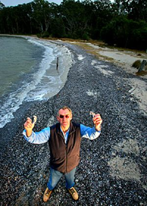 Ross Scott holds up shells on the shore of Lake Victoria.  He says a witches' brew of nutrients swept into the Gippsland ...