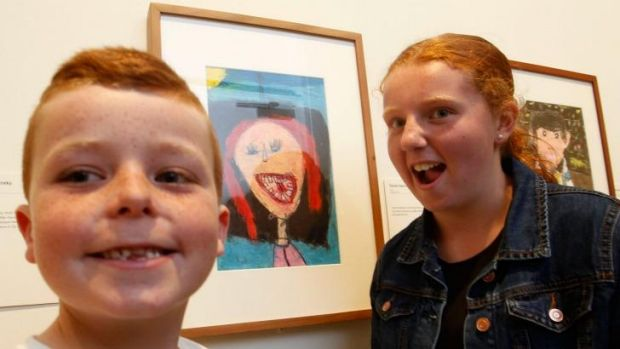 Artist and model: Daniel Harford, with his Young Archie-winning portrait and its subject, his sister Kasey.