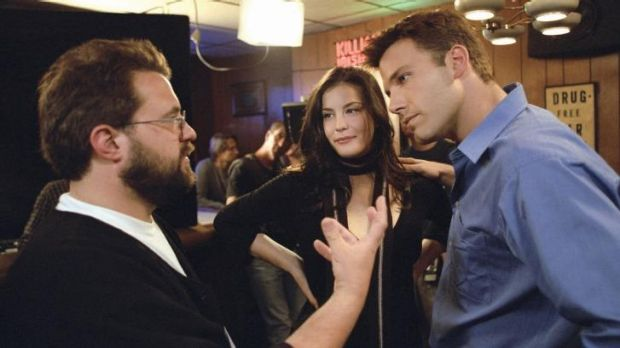 Director Kevin Smith, left, with Liv Tyler and Ben Affleck on the set of 2004 film <i>Jersey Girl</i>.