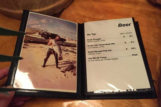 The beer menu, complete with majestic fishing pictures.