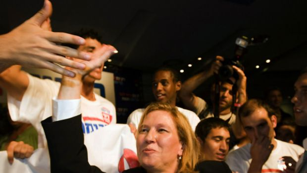 Foreign Minister Tzipi Livni shakes hands with young supporters  in Tel Aviv. She won by only 431 votes out of