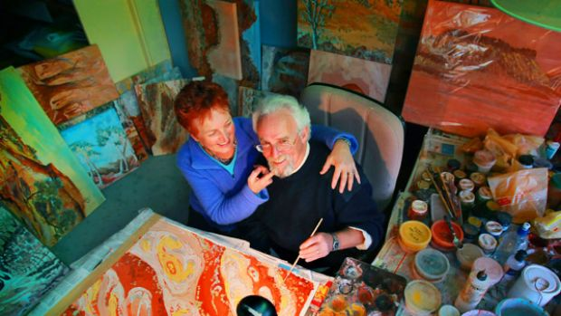 New perspective: Nick and Heather Safstrom with some of the paintings Nick has created since he lost the ability to ...
