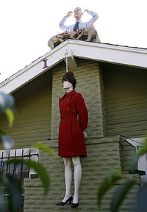 A mannequin portraying Sarah Palin hangs by a noose, while a mannequin portraying John McCain protrudes from the chimney ...