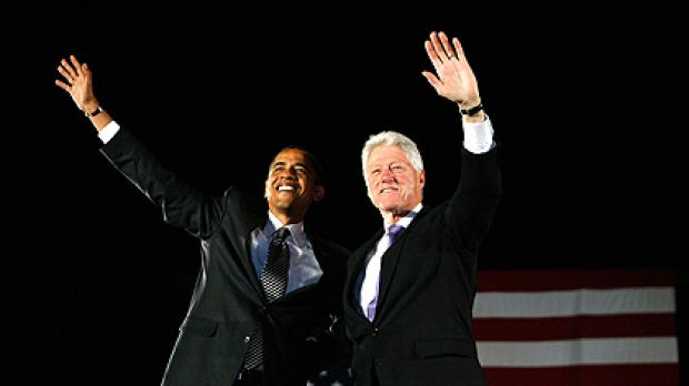 Barack Obama (left) and former President Bill Clinton stand together during a campaign rally in Orlando, Florida.