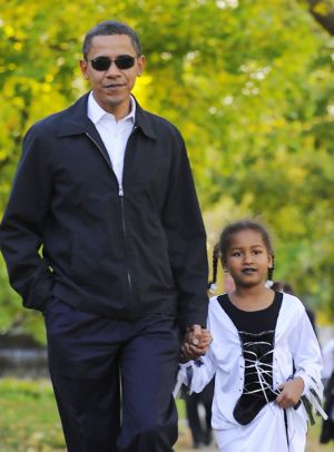 Senator Barack Obama and his daughter Sasha, 7, dressed up for Halloween.