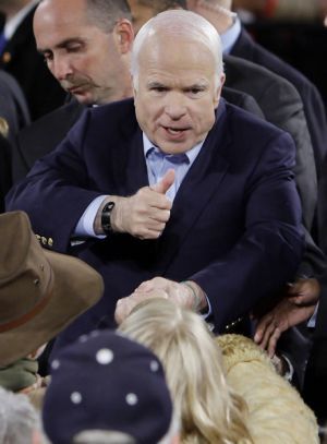 John McCain greets supporters at the midnight rally in Prescott.