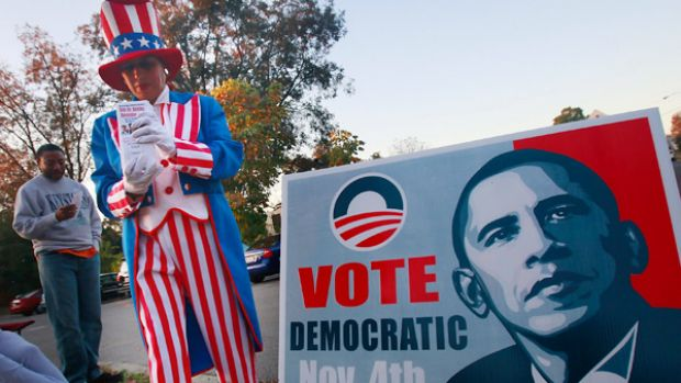 A Democrat supporter goes into the heart of the south, Birmingham, Alabama, to hand out how-to-vote cards.