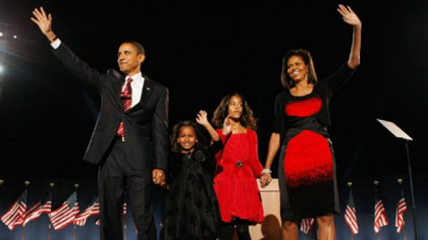 US President-elect Barack Obama with wife Michelle - in that dress - and daughters Malia (red dress) and Sasha (black ...