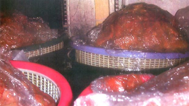 Restaurant closed ... raw beef exposed to potential contamination sits under a refrigerator.