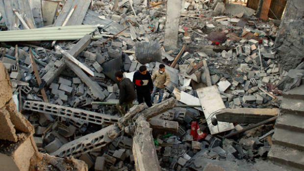 Palestinians inspect the rubble of a building destroyed by Israeli forces in Rafah refugee camp, southern Gaza.
