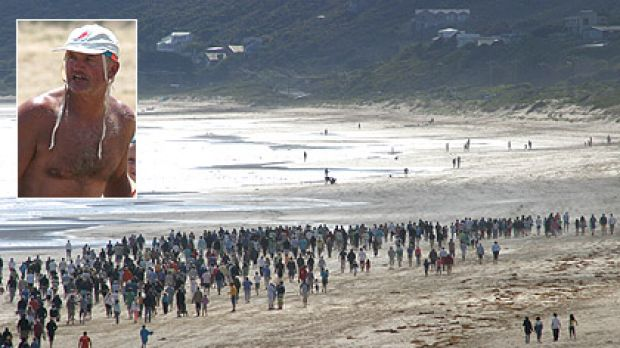 Along the beach where Tim Gates (inset) surfed and died, the crowd honoured his memory on Saturday with his family.
