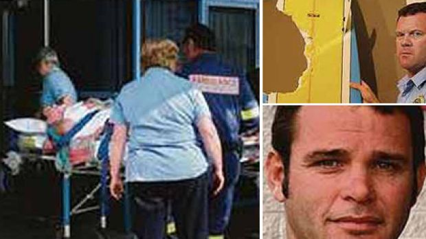 Paramedics take Hannah Mighall to hospital after the attack that left a large chunk mising from her surfboard. Her ...