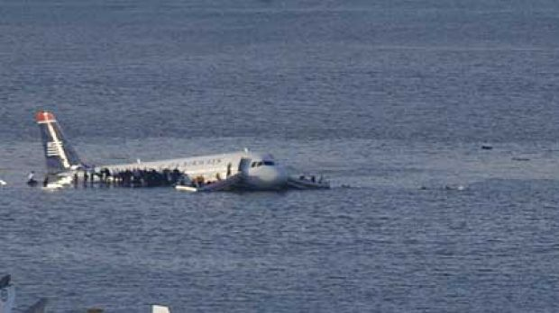 Passengers stand on the wings of a US Airways plane after it landed in the Hudson River in New York. The Airbus, with ...