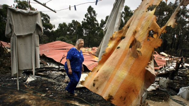 Devastating: Lori Mansfield wanders through the remains of what was once her Boolarra home.