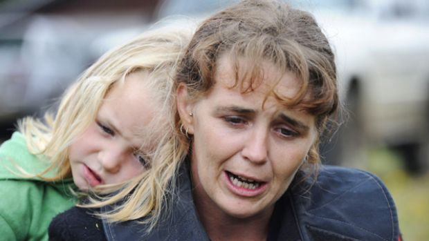 """Shell shocked: Heather Perring and daughter Phoebe huddle outside the Kinglake CFA shed. """"There was just no warning, no ..."""