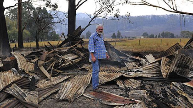 Graeme Beasley inspects his property damage in the town of Koornalla near Churchhill.