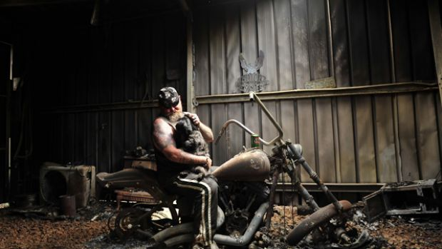 Fiery exhaust note: Rob Greig, with Missy on his knee, returns to Flowerdale to find his prized Harley-Davidson a ...