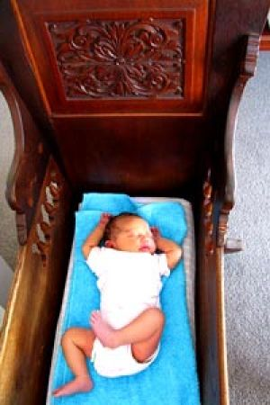 'Glimmer of hope' ... Five-week-old Tearia Mortimer in the cot made by Reg Evans.