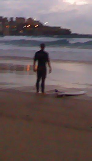 Not put off ... Nick Barry, who went out for a surf at Bondi this morning.