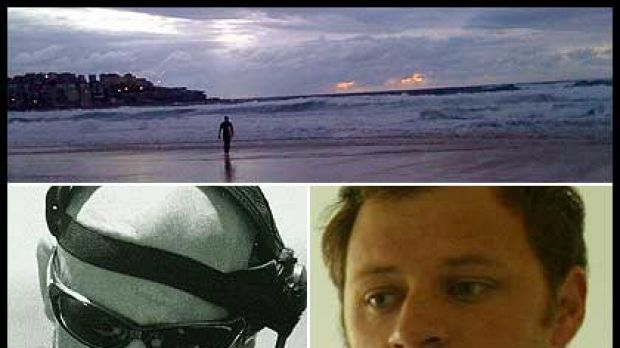 A lone surfer looks out at Bondi this morning after shark attacks on Paul de Gelder, left, and last night's victim Glenn ...