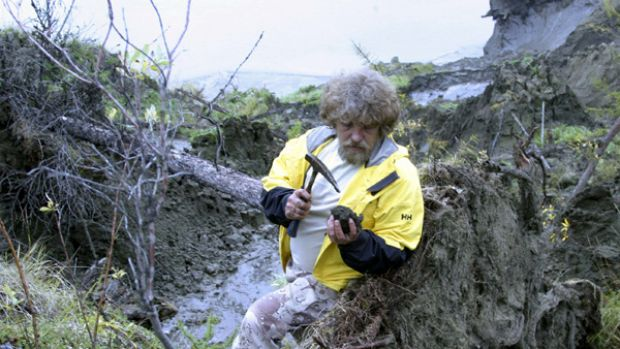 Scientist Sergei Zimov tests a sample of ground taken from a layer of melting permafrost in Siberia.